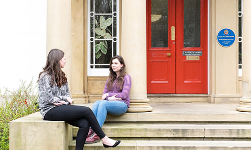 Students sat outside halls of residence